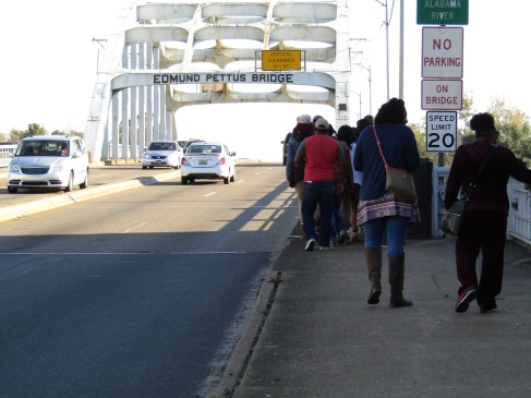Students walking over the Pettus Bridge in Selma.
