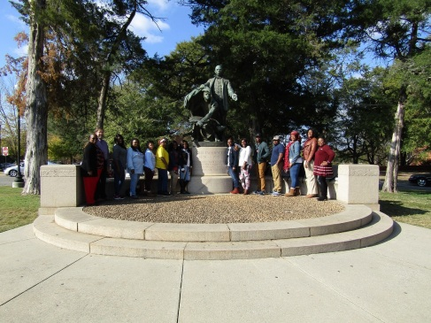 Utica humanities students and faculty at the BTW monument.